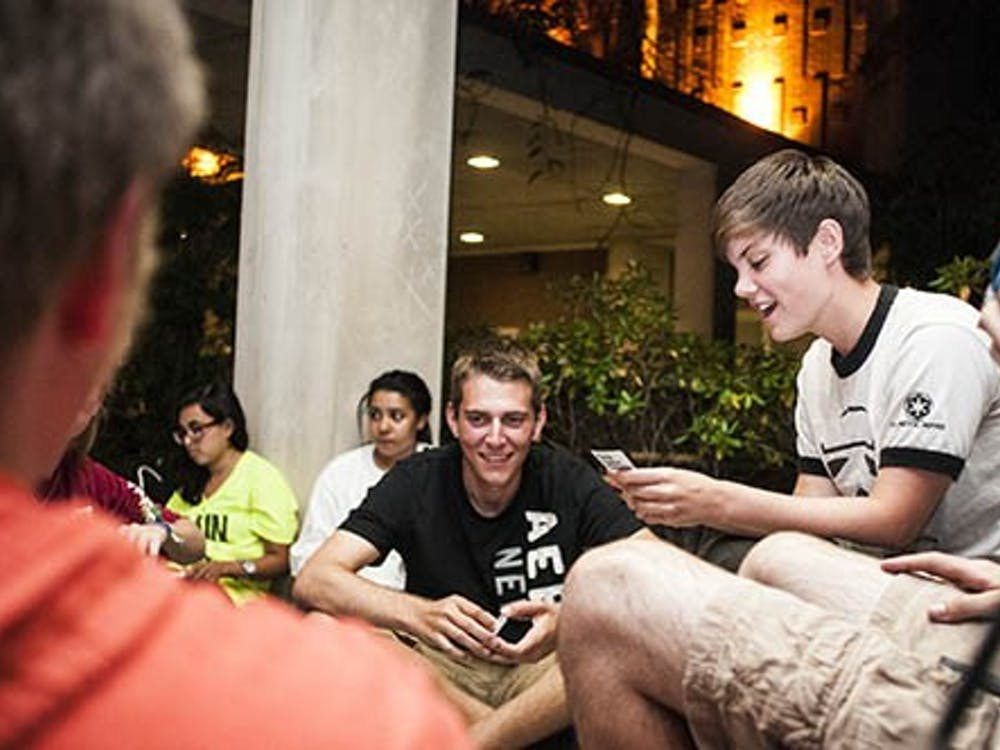 Students play Cards Against Humanity as they wait for Jason Mraz tickets. The Emens Box Office opens Sep. 6 at 8 a.m. DN PHOTO JONATHAN MIKSANEK