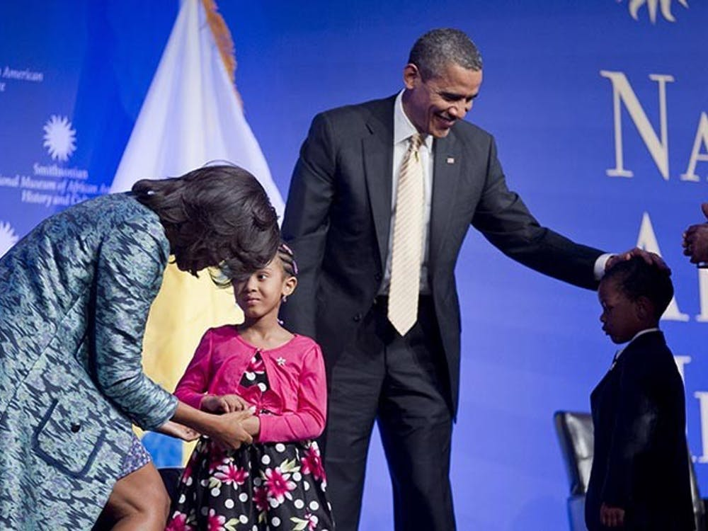 President Barack Obama and first lady Michelle Obama, left, greet children from a local Montessori school at the groundbreaking ceremony of the Smithsonian National Museum of African American History and Culture with Lonnie Bunch, director of the museum, far right, in Washington, D.C., February 22, 2012. (Andrew Harrer/Abaca Press/MCT)