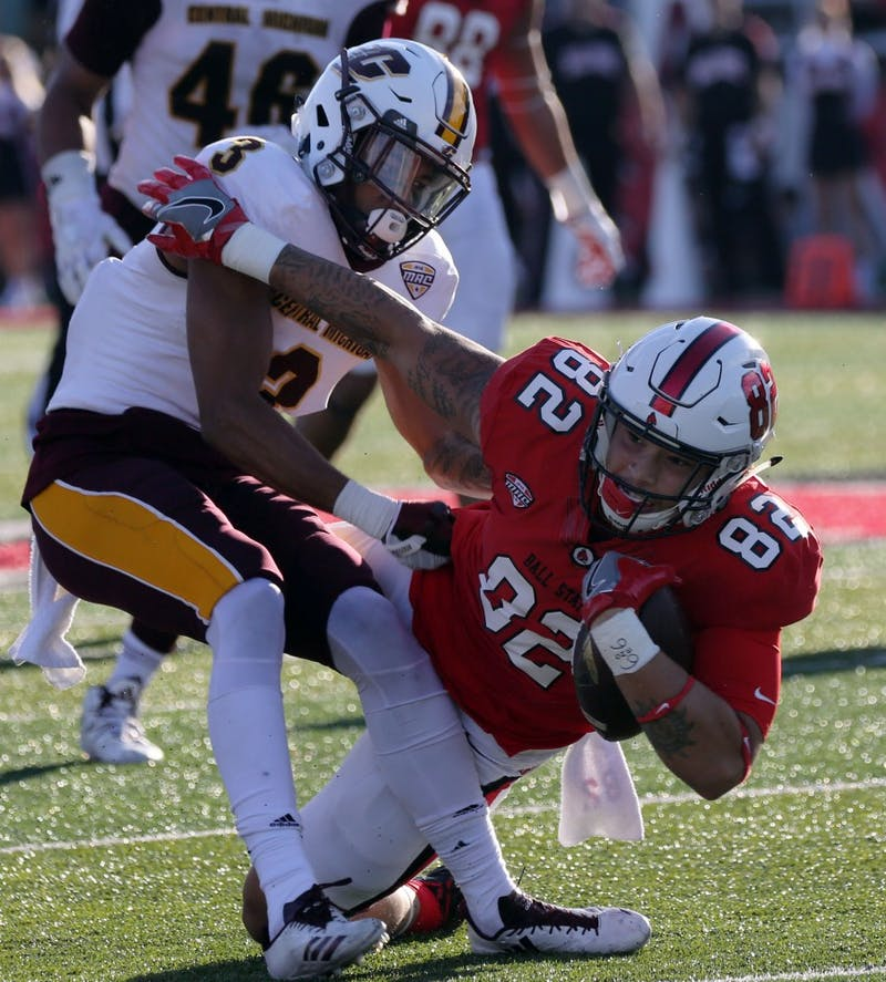 Redshirt freshman Keidren Davis gets tackled by Central Michigan's Sean Bunting during the Cardinals' game against the Chippewas on Oct. 21 at Scheumann Stadium. Ball State is playing Toledo Oct. 26 at home. Paige Grider, DN