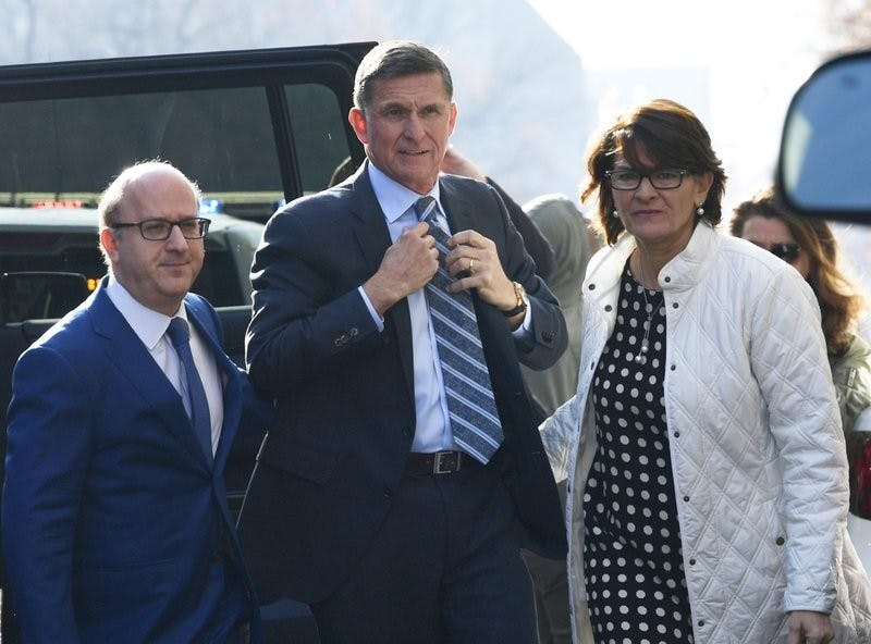 Former Trump national security adviser Michael Flynn, center, arrives at federal court in Washington, Friday, Dec. 1, 2017. Court documents show Flynn, an early and vocal supporter on the campaign trail of President Donald Trump whose business dealings and foreign interactions made him a central focus of Mueller's investigation, will admit to lying about his conversations with Russia's ambassador to the United States during the transition period before Trump's inauguration. AP Photo