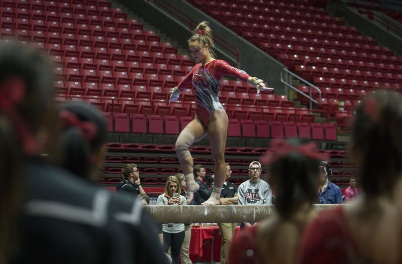 Members of the gymnastics team watch teammate senior Sarah Ebeyer perform her routine on the beam during the meet against Kentucky Jan. 29 at John E. Worthen Arena. Breanna Daugherty // DN