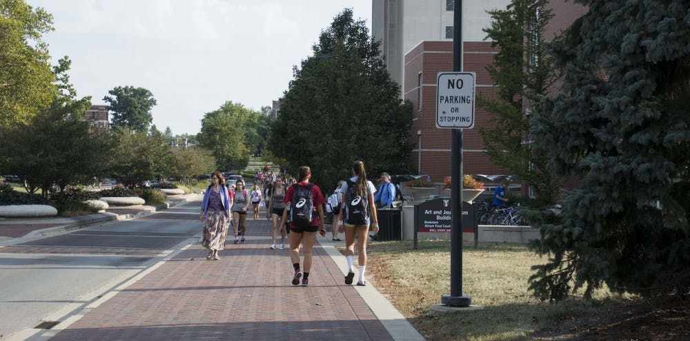 <p>Students walk past the Art and Journalism Building, which is connected on the second floor to Ball Communications, the David Letterman Communication and Media Building and the Robert Bell Building. Freshmen can avoid getting lost in campus buildings by pulling up their class schedule on their phones. <strong>Samantha Brammer, DN FIle</strong></p>
