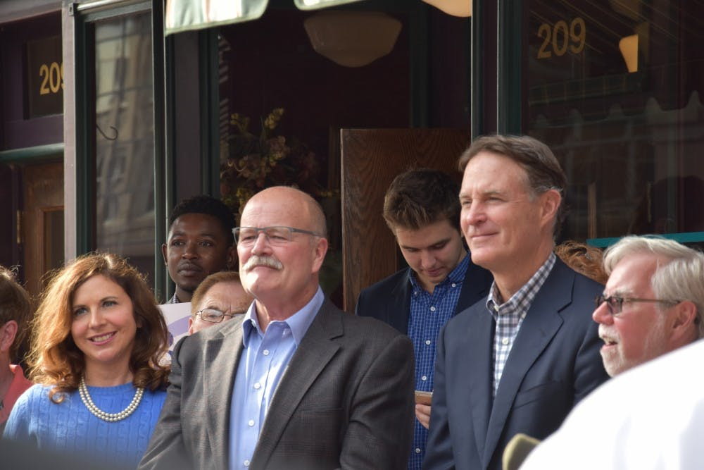 <p>(From left) Democratic politicians Christina Hale, John Gregg and Evan Bayh came to speak about issues in Indiana in front of Vera Mae's Bistro in downtown Muncie on Nov. 2. The candidates&nbsp;running for state and national offices spoke about Delaware County, the city of Muncie and Ball State students.&nbsp;<em>Patrick Calvert // DN&nbsp;</em></p>