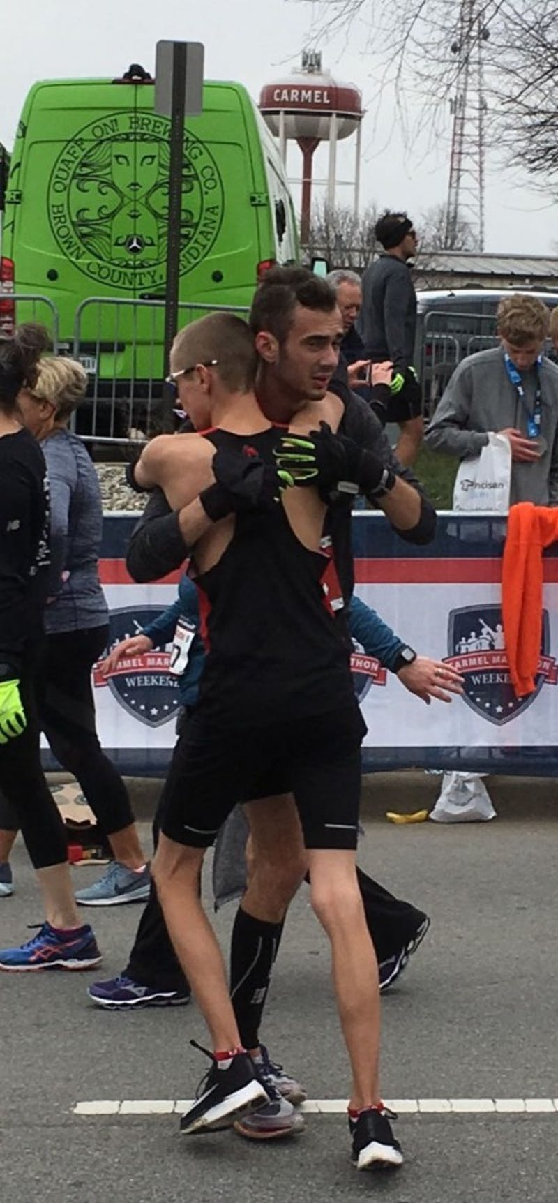 Junior Chris Meyer embraces junior John Brown after the two qualified for the Boston Marathon at the Carmel Marathon on March 31, 2018 in Carmel, Indiana. Junior Katie Fedoronko qualified alongside Meyer and Brown for the Boston Marathon. Chris Meyer, Photo Provided