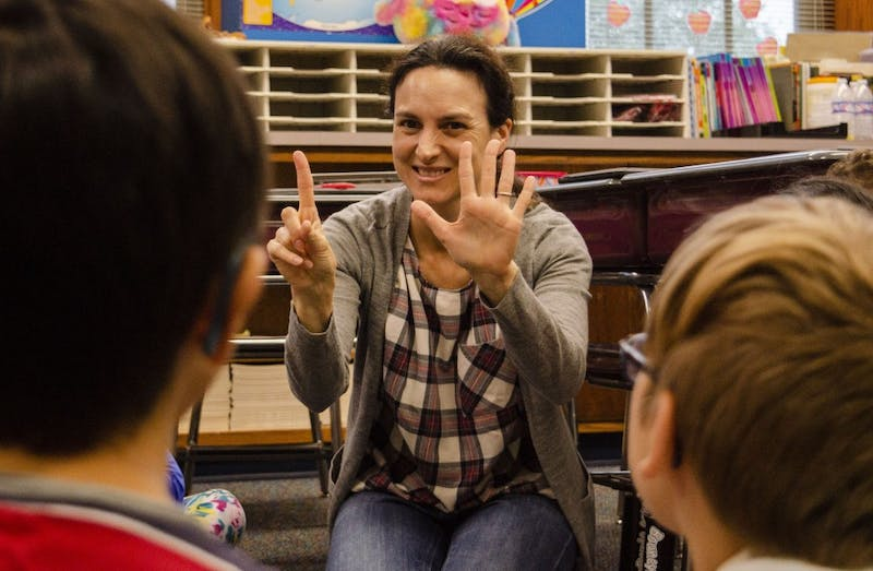 Ball State professor Beatriz Cobeta holds up six fingers to the third graders in Mrs. Karne's class, Sept. 25, at the Burris Laboratory School. Cobeta volunteers at the school to teach Spanish for a brief time in class. Students or professors volunteer their time to teach Spanish basics, such as numbers and letters. Stephanie Amador, DN