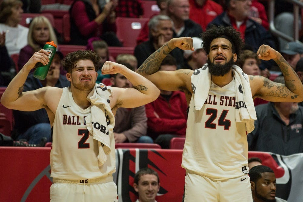 <p>Seniors Tayler Persons and Trey Moses flex after Ball State scores on Toledo during the game in Worthen Arena Feb. 17, 2018. The Cardinals won 99-71. <strong>Eric Pritchett, DN File</strong></p>