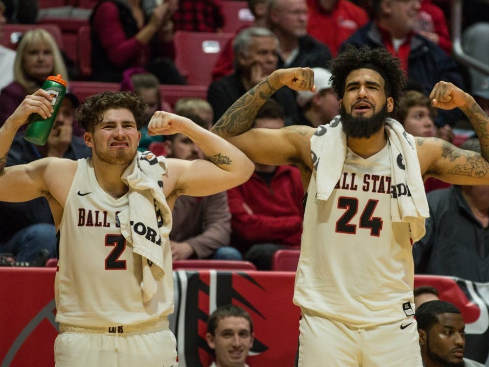 Seniors Tayler Persons and Trey Moses flex after Ball State scores on Toledo during the game in Worthen Arena Feb. 17, 2018. The Cardinals won 99-71. Eric Pritchett, DN File