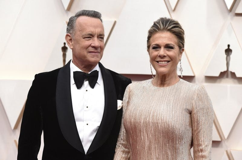 """In this Feb. 9, 2020 photo, Tom Hanks and Rita Wilson arrive at the Oscars at the Dolby Theatre in Los Angeles. The couple have tested positive for the coronavirus, the actor said in a statement Wednesday, March 11. The 63-year-old actor said they will be """"tested, observed and isolated for as long as public health and safety requires."""" (Photo by Jordan Strauss/Invision/AP, File)"""