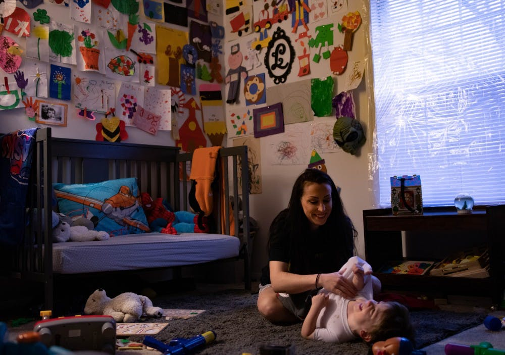 <p>Kileah Adkins tickles Lucien Miller after putting on his pajamas April 11, 2019, at their apartment in Muncie, Indiana. <strong>Rebecca Slezak, DN</strong></p>