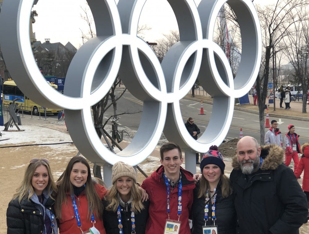 <p>The BSU at the Games team stands in front of the Olympic rings outside of the media center after a day of reporting. <strong>Ryan Sparrow, Photo Provided</strong></p>