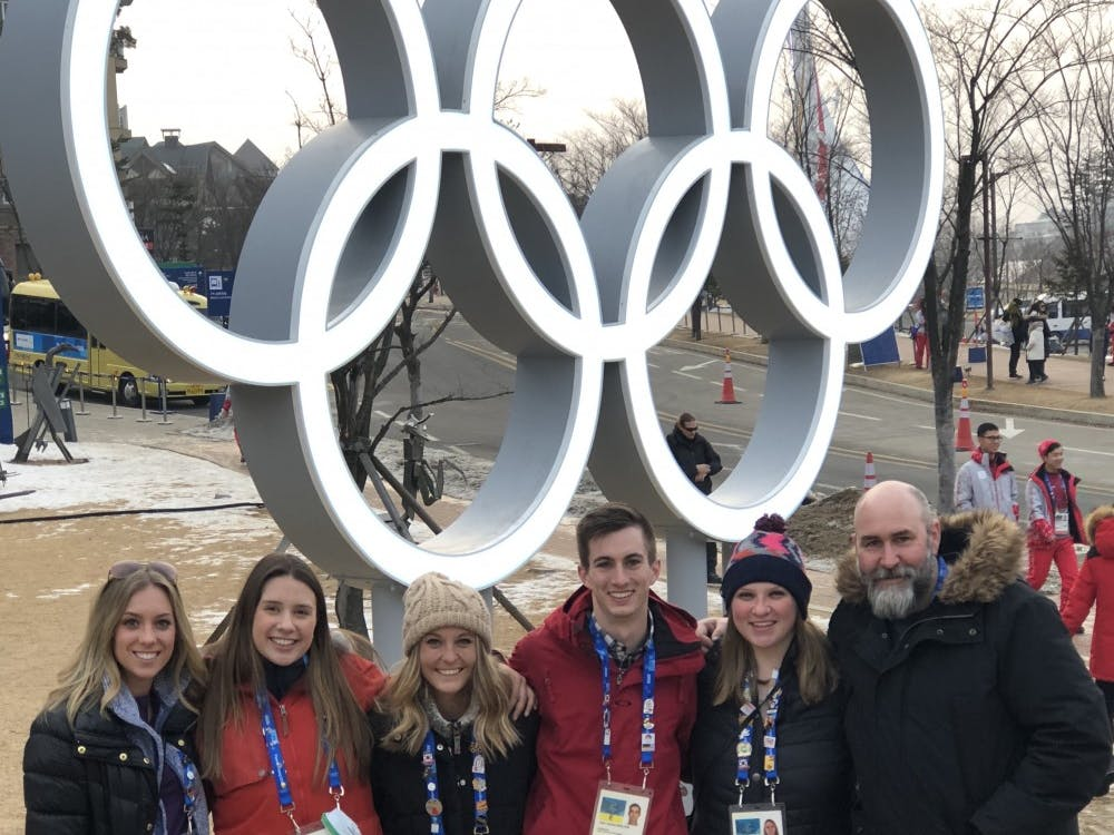 The BSU at the Games team stands in front of the Olympic rings outside of the media center after a day of reporting. Ryan Sparrow, Photo Provided