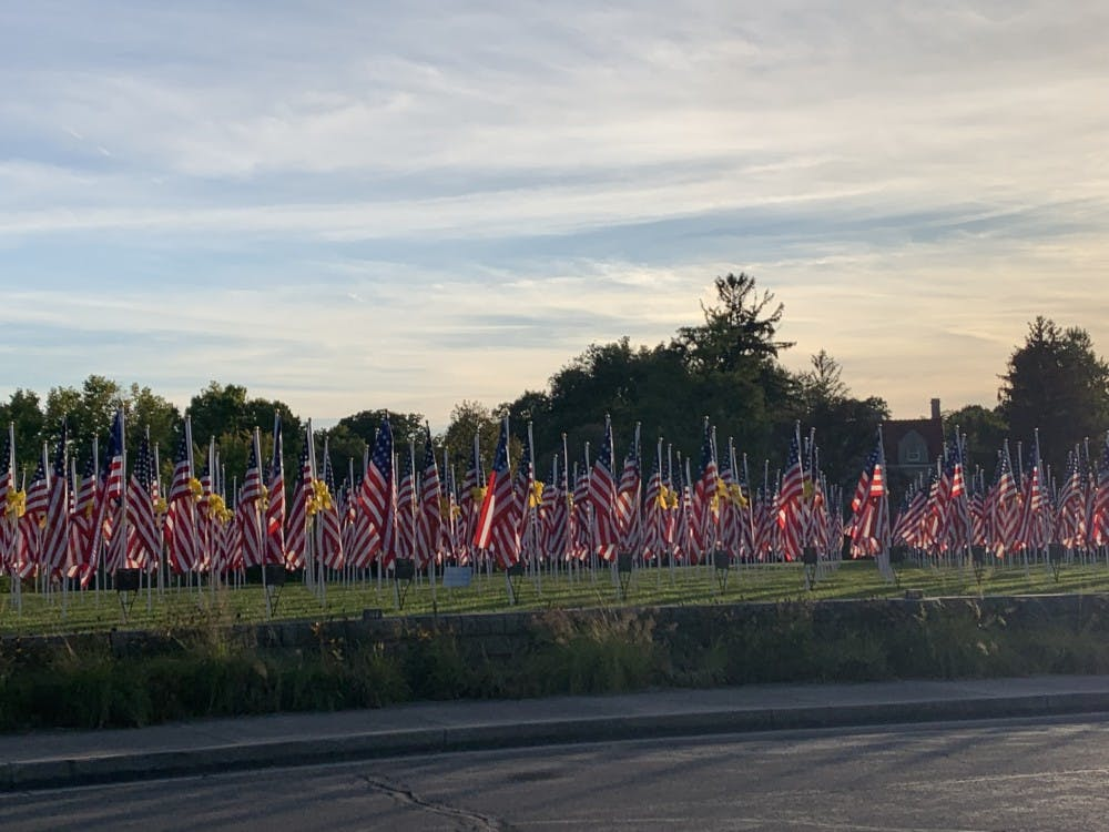 100 flags stand in Minnetrista's field to honor service personnel and first responders as September 11th approaches.