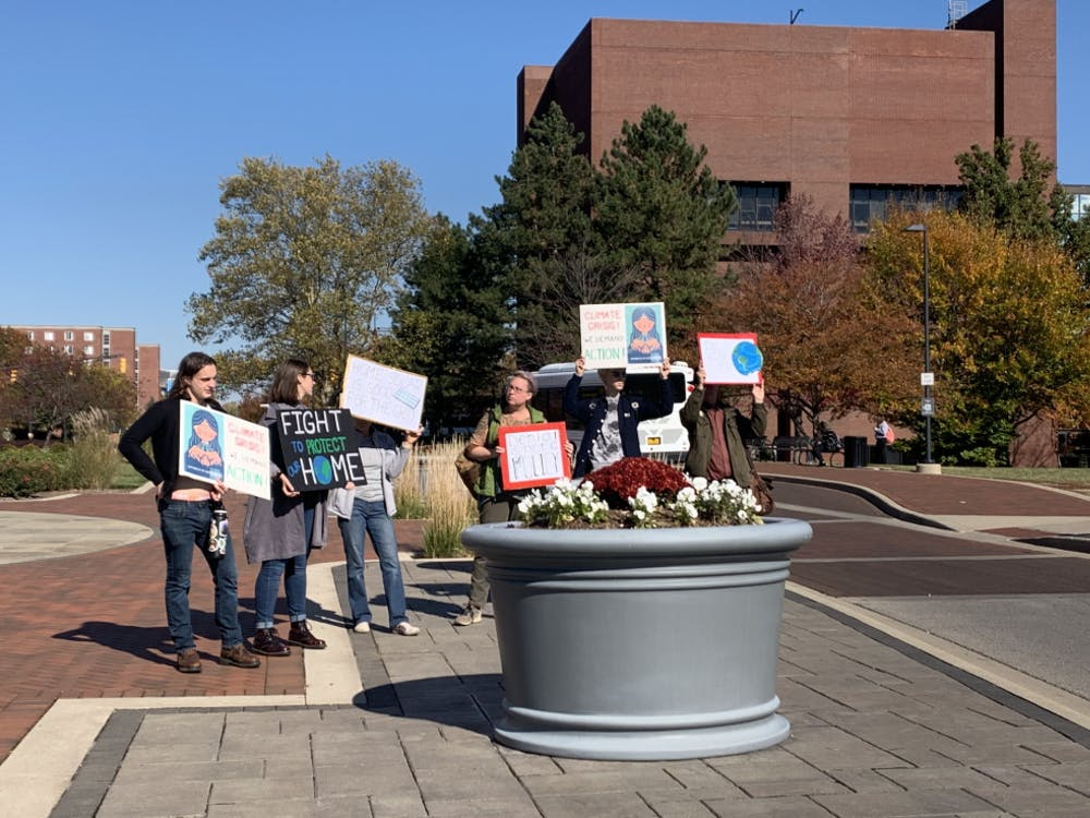 On Monday, Oct. 28, students and activists gathered at Shafer Tower with homemade signs as a part of a climate strike. The strike, organized by a student, took place around noon at the tower and later marched up McKinley toward Ball State's quad.