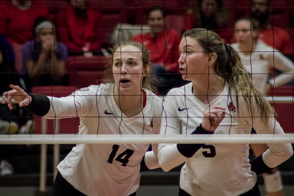 <p>Ball State junior outside hitter Kia Holder talks with freshman middle blocker Marie Plitt before the next serve Nov. 16, 2019, in John E. Worthen Arena. The Cardinal's next game will be in Bowling Green, Ohio during the MAC volleyball championship. <strong>Eric Pritchett, DN</strong></p>