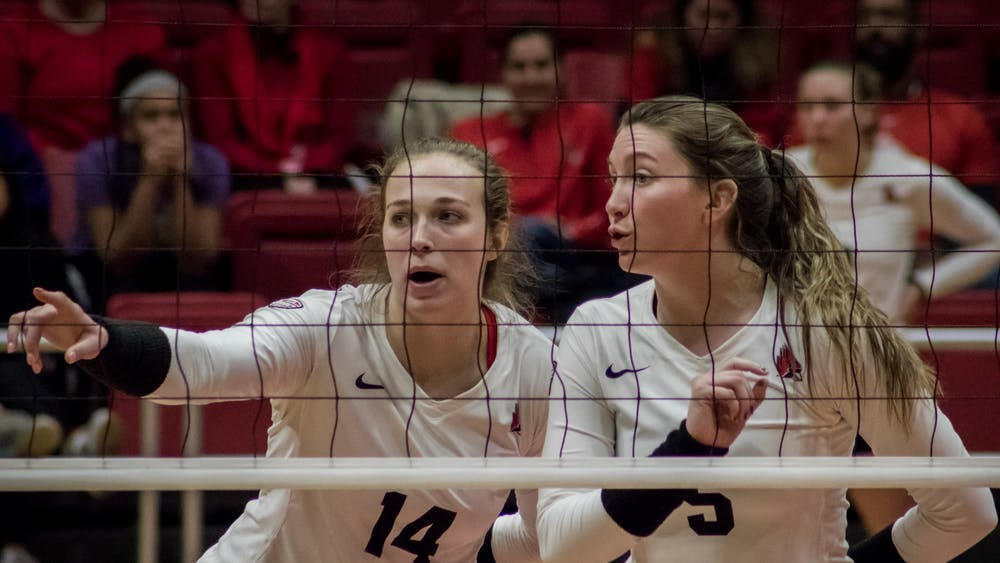 Ball State junior outside hitter Kia Holder talks with freshman middle blocker Marie Plitt before the next serve Nov. 16, 2019, in John E. Worthen Arena. The Cardinal's next game will be in Bowling Green, Ohio during the MAC volleyball championship. Eric Pritchett, DN