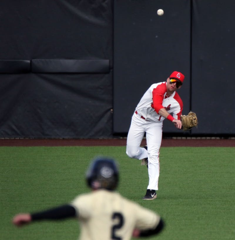 Ball State junior center fielder Aaron Simpson throws the ball in field as Purdue sophomore second baseman Tyler Powers hesitates between second and third during the Cardinals' game against the Boilermakers March 19, 2019 at Ball Diamond at First Merchants Ballpark Complex in Muncie, IN. Ball State's 6 to 0 win over Purdue gives them a 11-9 record. Paige Grider, DN