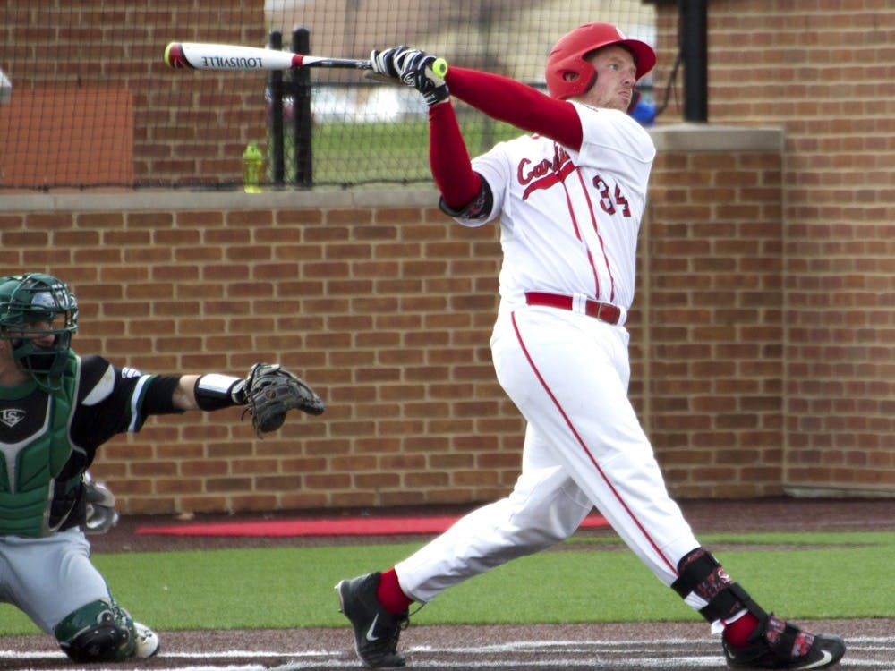 Caleb Stayton, a junior catcher and first baseman for the Ball State Cardinals, attempts to hit the ball while up to bat in the game against Ohio on April 1. DN PHOTO GRACE RAMEY