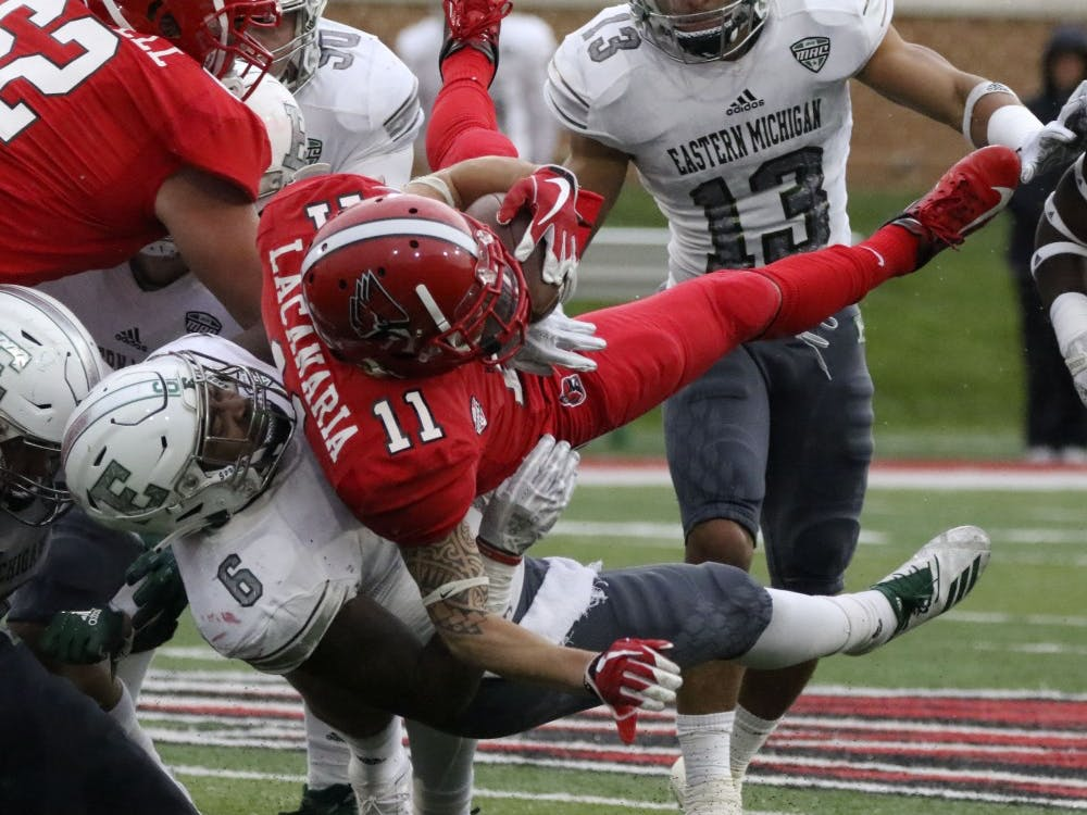 Ball State redshirt senior wide receiver Corey Lacanaria gets tackled by Eastern Michigan University's Jaylen Pickett during the Cardinals' game against the Eagles Oct. 20, 2018 at Scheumann Stadium. Pickett had two solo tackles. Paige Grider, DN