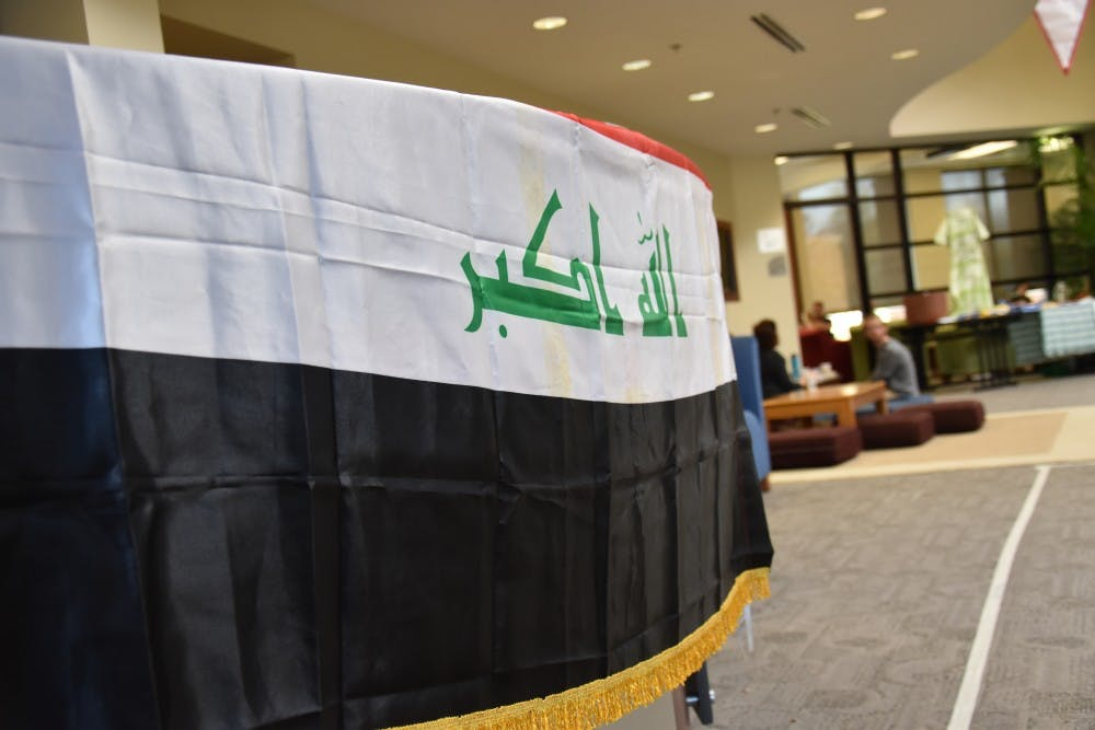 """<p>The Iraqi flag sits on a table at the """"Because They Are Me"""" charity event on Nov. 5 at the Innovation Connector. The event was hosted by Muncie locals and refugees from Iraq in an effort to help ease the struggles of refugees in northern Iraq.&nbsp;<i style=""""font-size: 14px;"""">Patrick Calvert // DN</i></p>"""