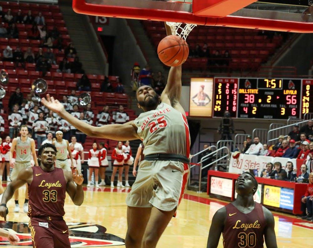 Senior Forward, Tahjai Teague (25), punishes the rim against Loyola Chicago Dec 3, 2019 at John E. Worthen Arena. Teague had 14 points in a 70-58 loss. Omari Smith, DN