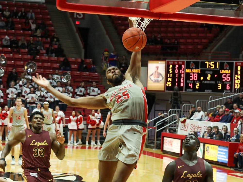 Senior Forward, Tahjai Teague (25), punishes the rim against Loyola Chicago Dec 3, 2019 at John E. Worthen Arena. Teague had 14 points in a 70-58 loss. Omari Smith, DN