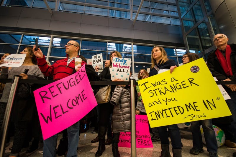 Hundreds of protestors surround the baggage carousel, at the Indianapolis Airport on Jan. 29, after President Trump's executive orders on immigration. Stephanie Amador // DN
