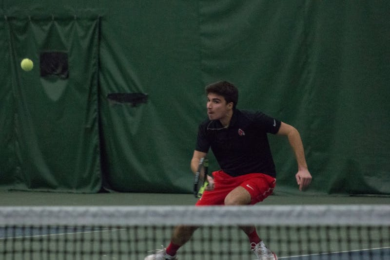 Junior Nemanja Guzian goes after the ball in a tennis match against IU Southeast at Northwest YMCA in Muncie, Ind. Feb. 3. Eric Pritchett, DN