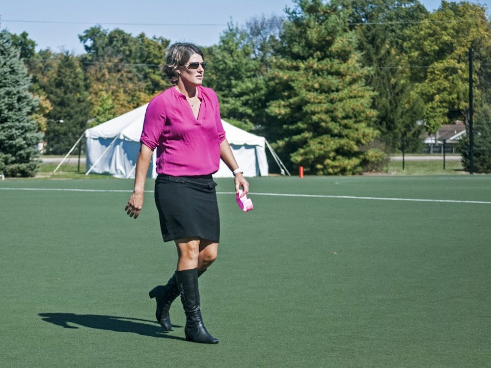 "Ball State field hockey coach Sally Northcroft walks off the field during halftime of the ""Think Pink"" game against Bellarmine University. Though Northcroft's Cardinals have struggled so far this season, they came alive to beat Bellarmine, 7-1. DN PHOTO COLIN GRYLLS"