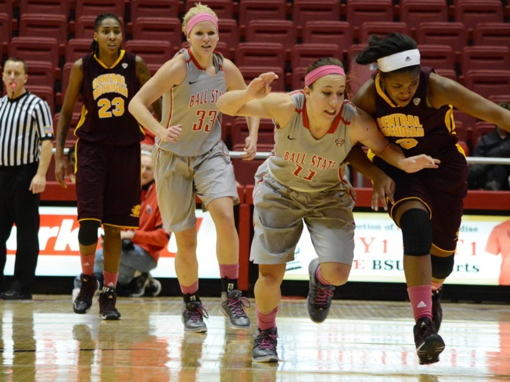 Jessica Green, Central Michigan, and Brandy Woody fight for the ball on Feb. 6 in Worthen Arena . Ball State fell to Central Michigan after the game went into overtime. DN PHOTO SAMANTHA BLANKENSHIP
