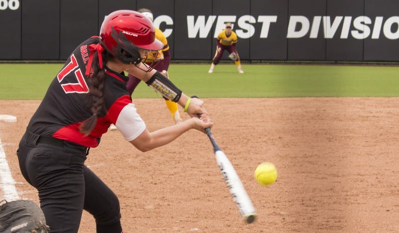 Ball State senior Brittany Hopper hits the ball during the first game against Central Michigan April 21 at the softball field at First Merchant's Ballpark Complex. Briana Hale, DN