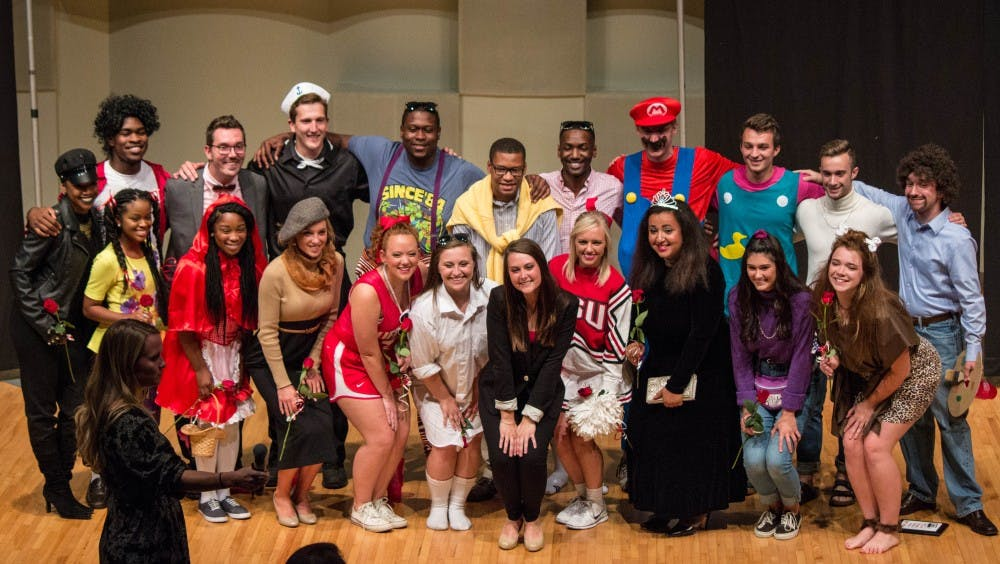 The top 10 kings and queens for the 90th Homecoming pose for a picture after the Homecoming Royalty Reveal ceremony on Sept. 27 in John J. Pruis Hall. The event featured 78 candidates who competed for best costume before being were narrowed down. Grace Ramey // DN