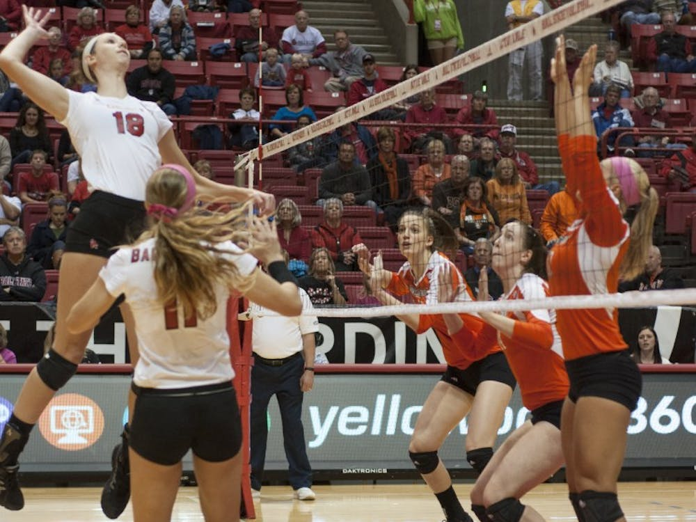 Sophomore middle hitter Hayley Benson goes up for a spike against Bowling Green State University on Oct. 25 at Worthen Arena. Benson finished with nine kills during the match. DN PHOTO MATT McKINNEY
