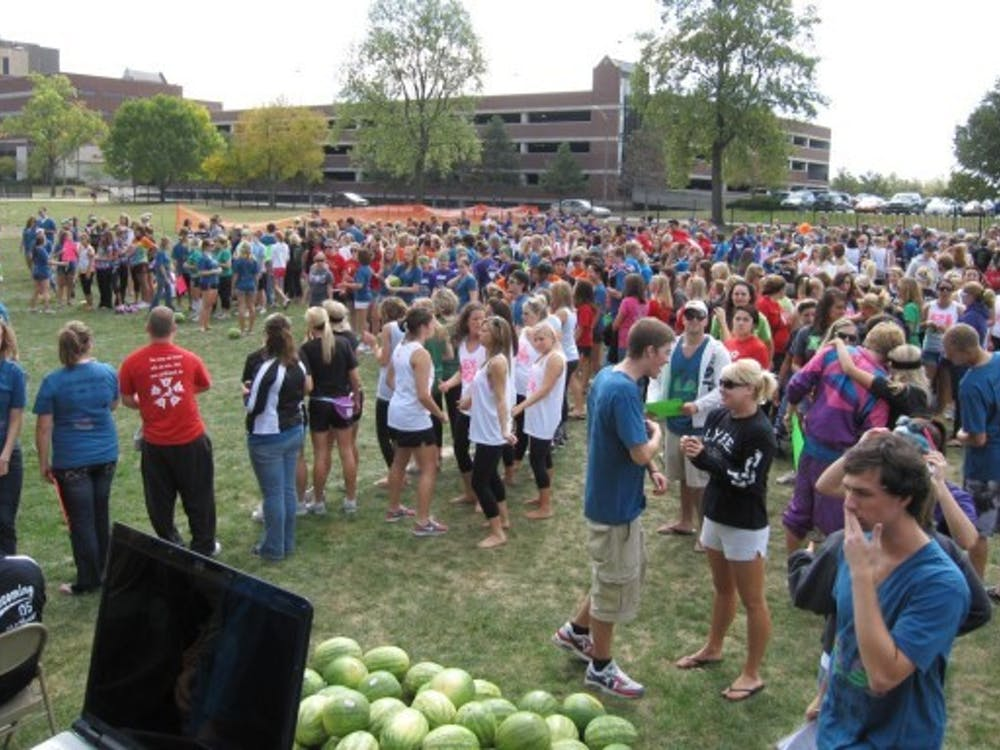 Hundreds of students wait for Watermelon Bust to start. Watermelon Bust was moved to West Campus Field because of geothermal construction on Lafollette Field. PHOTO COURTESY OF WADE BAERTSCHI