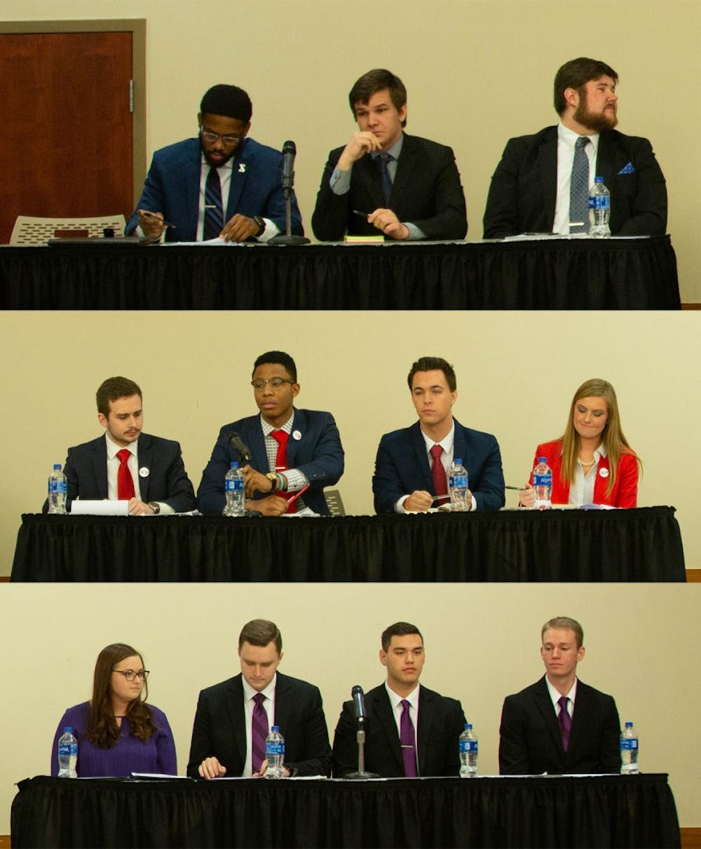 (Top to bottom) United slate candidates, Empower slate candidates and Elevate slate candidates sit during the All-Slate Debate in the L.A. Pittenger Student Center ballroom Feb. 18, 2019. Slates debated on a variety of topics. Scott Fleener, DN
