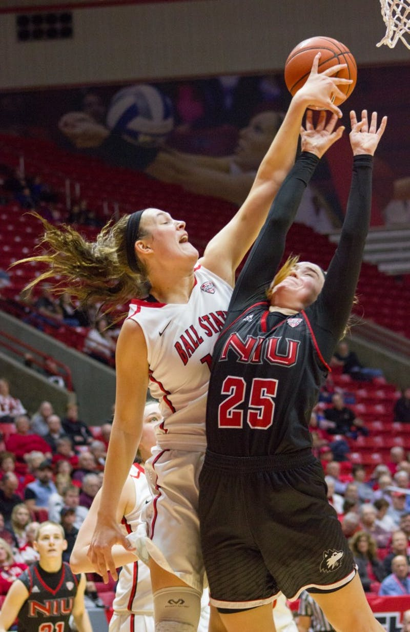 Senior Renee Bennett uses her height to steal a rebound from an opponent during the January 28th game against Northern Illinois at Worthern Arena.