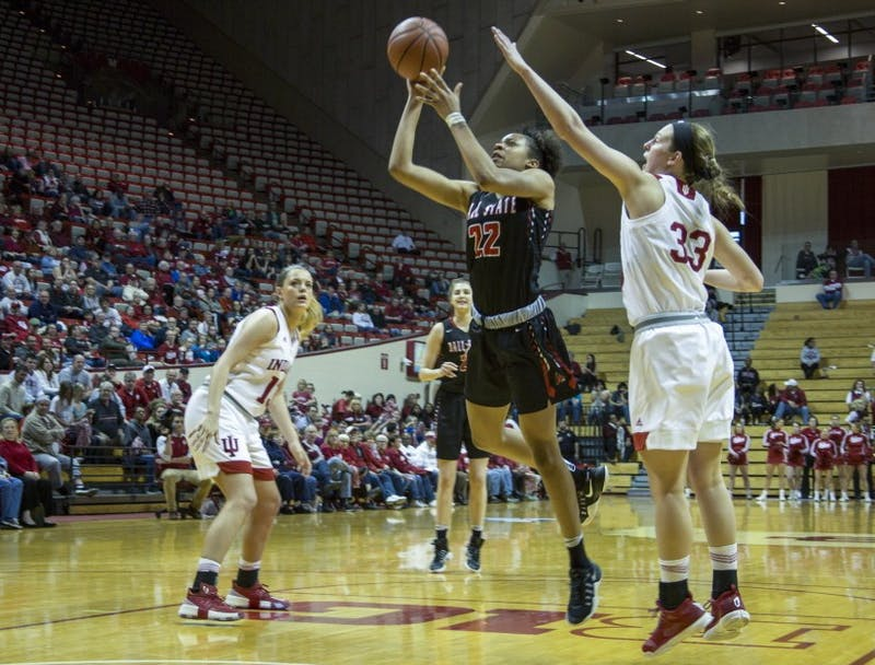 Sophomore guard Destiny Washington shoots the ball in Ball State's 71-58 loss to Indiana. The Cardinals were eliminated from the Women's National Invitation Tournament in the loss. Colin Grylls, DN File