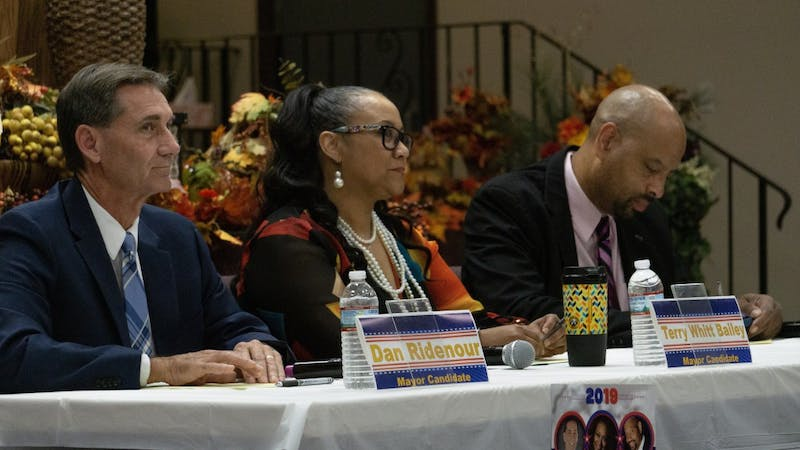 Dan Ridenour (R), Terry Whitt Bailey (D) and Steve Smith (L) wait for the forum to begin. The forum, hosted by the NAACP at Church of the Living God, touched on questions concerning the city's rental codes, corruption and the racial disparities within Muncie's police and fire departments. John Lynch, DN