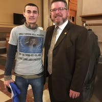Matt Peiffer (left) poses next to State Representative Kevin Mahan (right) after advocating for a bill in memory of his sister Emily. Peiffer said his sister died by suicide at age 18 after struggling with feelings guilty about what had happened to her and her siblings. Photo: Matt Peiffer.