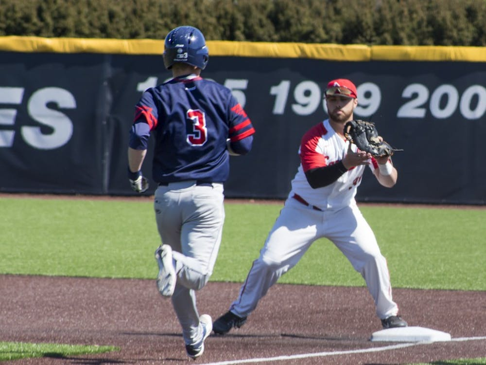 Ball State baseball player John Ricotta, 31, tags the base as Dayton player Connor Echols, 3, runs to first base during the game against the University of Dayton on March 18 at the Baseball Diamond at First Merchant's Ballpark Complex. Echols was called out. Briana Hale, DN