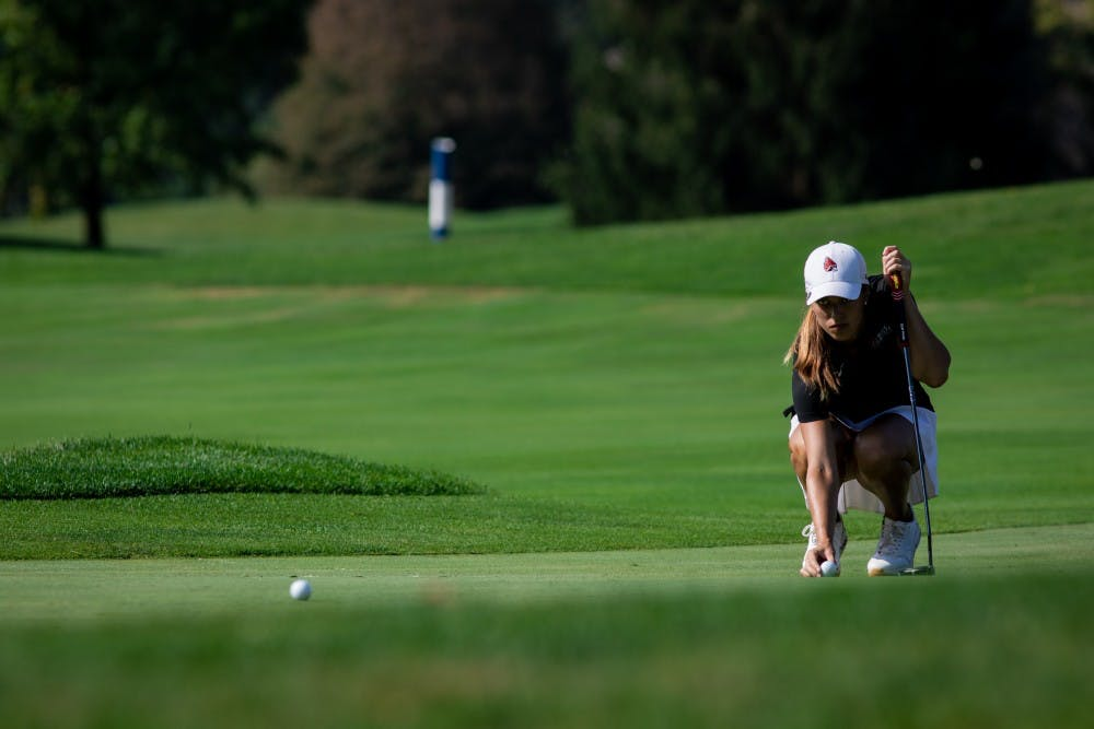 <p>Sophomore Hadley Moritz lines up her ball on the green Sept. 16, 2019, at the Players Club at Woodland Trails in Yorktown, Ind. Moritz ended the third round of the cardinal classic six above par. <strong>Eric Pritchett, DN</strong></p>