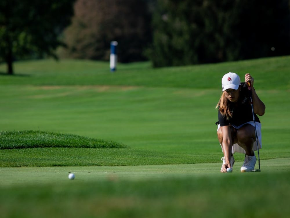 Sophomore Hadley Moritz lines up her ball on the green Sept. 16, 2019, at the Players Club at Woodland Trails in Yorktown, Ind. Moritz ended the third round of the cardinal classic six above par. Eric Pritchett, DN
