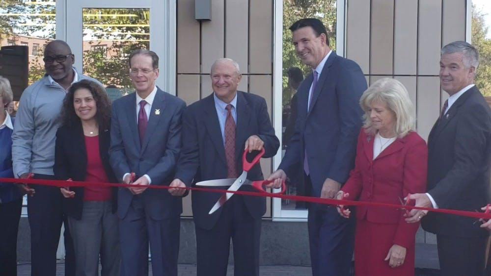Retired State Sen. Luke Kenley and Board of Trustees Chair Rick Hall along with other Ball State Board and administration members pose for a photo as they cut the ribbon Oct. 18, 2019, to inaugurate the Health Professions Building. The five-story, 165,000-square-foot building is part of a $210 million investment into a three-phase project at Ball State. Jaden Hasse, DN