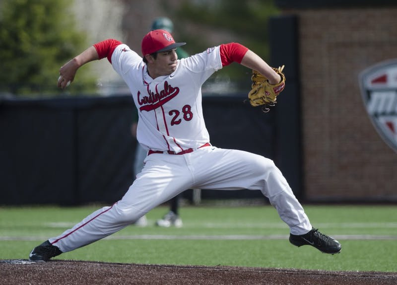 Sophomore pitcher TJ Harmon pitches the ball during the game against Ohio University on April 2 at the First Merchants Ballpark Complex. Ball State lost 10-0, bringing the Cardinals losing streak to eight games in a row. Emma Rogers // DN