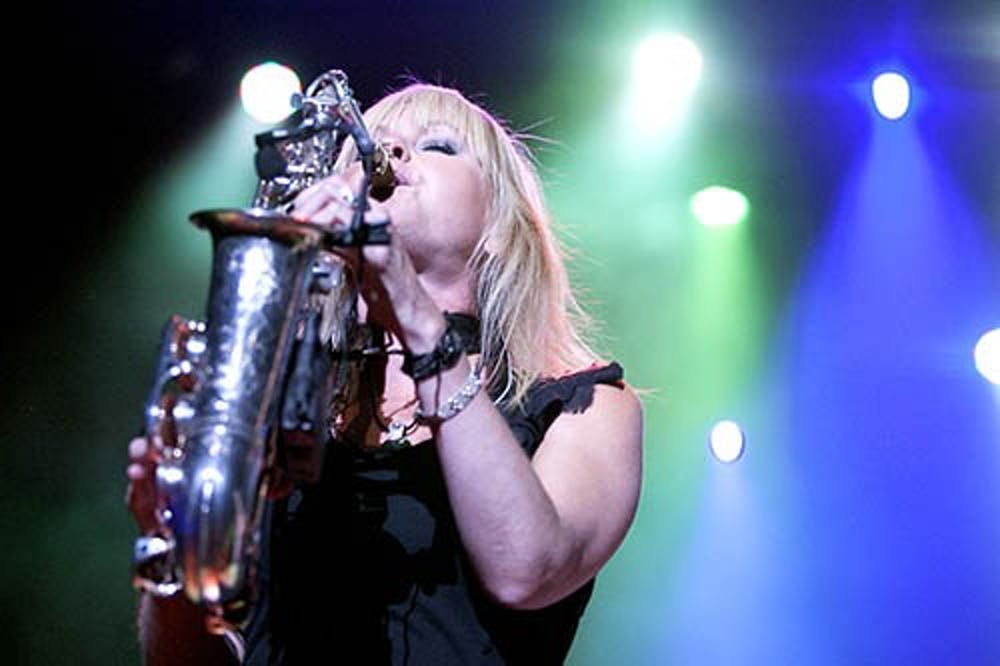 Saxophonist Mindi Abair takes center stage on Tuesday evening at Emens Auditorium. The concert was part of the Music for All Summer Symposium and was free to all the students who attended the camp. DN PHOTO JORDAN HUFFER