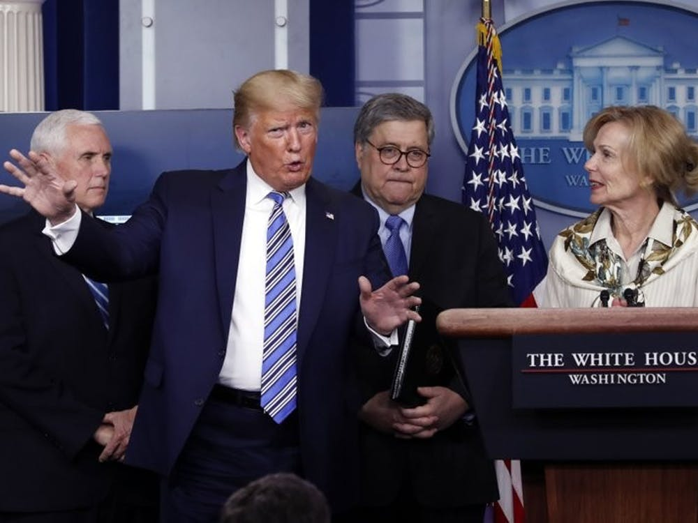 President Donald Trump gestures as he asks a question to Dr. Deborah Birx, White House coronavirus response coordinator, during a briefing about the coronavirus in the James Brady Briefing Room March 23, 2020, in Washington. (AP Photo/Alex Brandon)