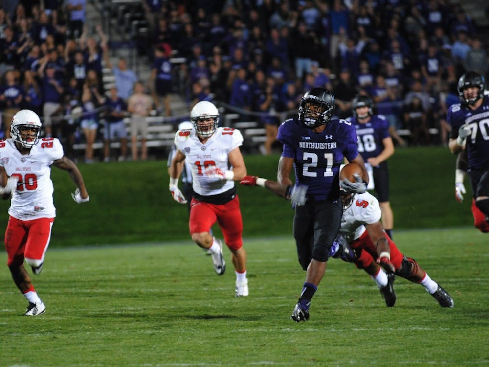Senior defensive end Michael Ayers attempts to tackle Northwestern