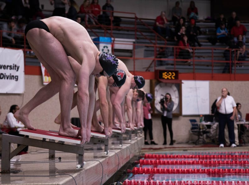 Swimmers prepare to enter the water at the Ball State v. Evansville meet at the Lewellen Pool Jan. 18, 2019. Jack Hart, DN