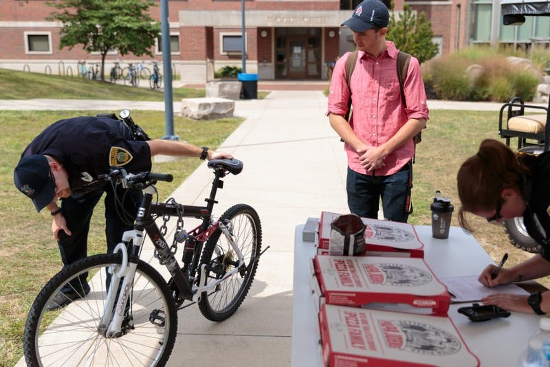 Freshman Brendan Kogiones registers his bike outside of DeHority Complex on Aug. 31. Participants got a slice of pizza for registering and a better chance at recovering a stolen bike, according to the Ball State University Police Department. Kyle Crawford, DN