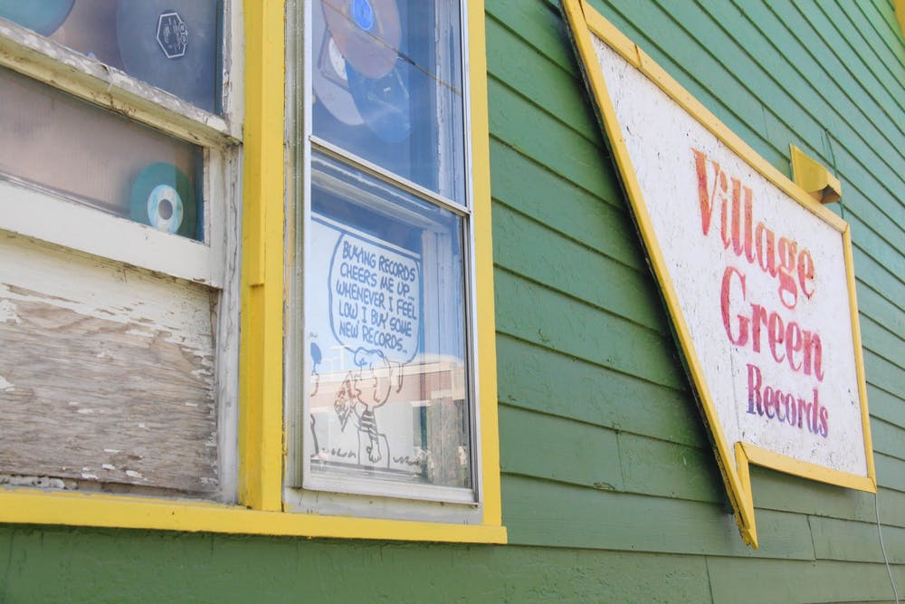 Village Green Records closed in-store visits in late March due to the COVID-19 pandemic, but has continued their business through online ordering and curbside pickup. They plan to do more sidewalk sales in the future to continue their business safely. Photo by Adele Reich.