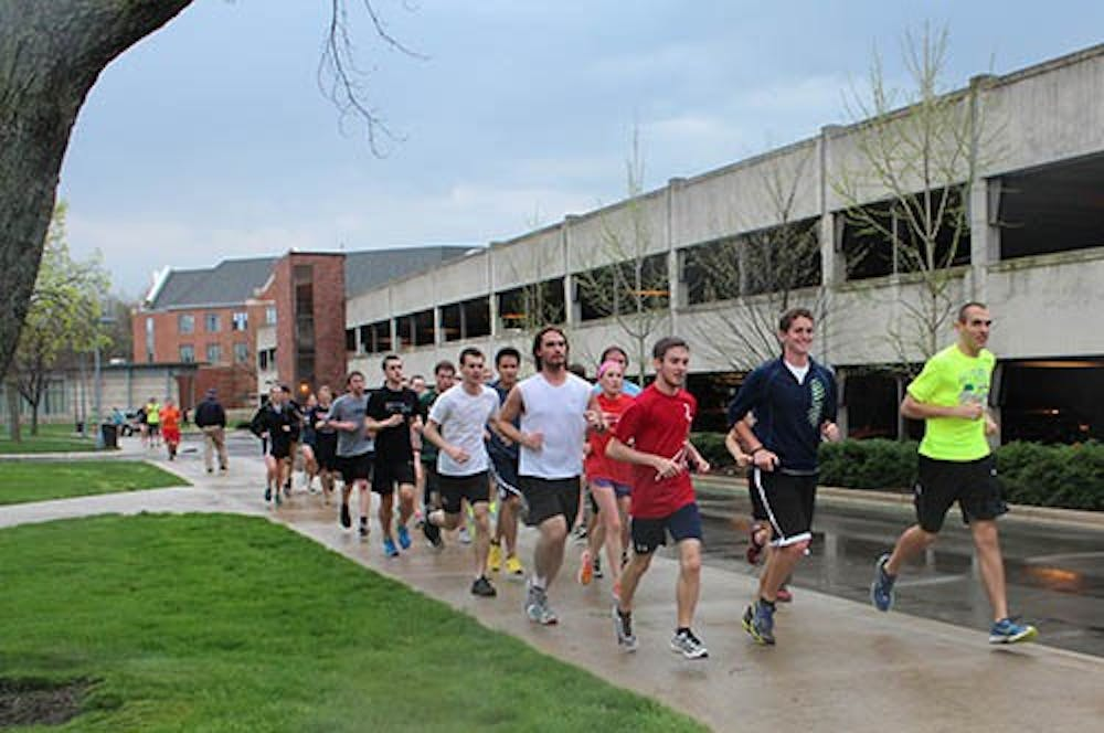 Runners for the Unity Run move past Noyer Complex on April 18, 2013 to show their support for the victims of the Boston Marathon bombing. Justin Miller and Josh Fern from the Ball State Runners Association planned the event, and one student who grew up near Boston participating in the run. DN PHOTO TAYLOR IRBY